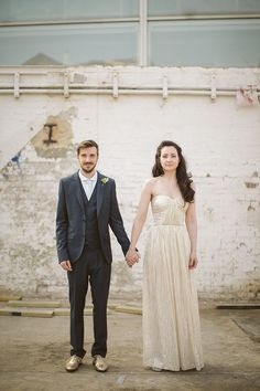 A groom in gold brogues and a bride in a gold wedding dress.  http://www.tomravenshear.com/