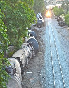 Environmental watchdog, Columbia Riverkeeper, said derailed train cars were still leaking when Union Pacific started moving cargo on rebuilt tracks in less than a week after the Oregon-Columbia River derailment disaster.