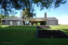 McKinney + Windeatt Architects look at exterior photos heavy timbers painted/stained black, black stone but white interiors Contemporary Barn, Modern Barn, Modern Farmhouse, Style At Home, Casas Containers, Long House, Gable Roof, Shed Homes, House Roof