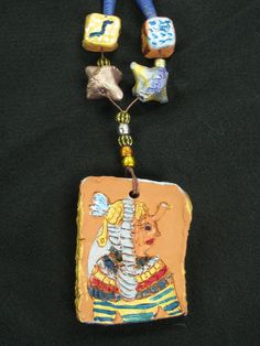 """4th grade ancient Egyptian ceramic necklace with terra cotta beads; pendant approx. 2"""" X 3""""; lesson by art teacher: Susan Joe"""