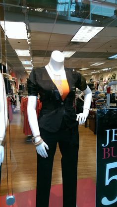 Just a pop of orange is all you need with this black cap sleeve suit from @ftfpins .  #OITNB