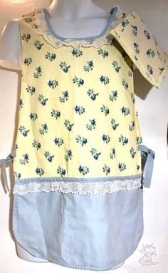 Aprons Cobbler Slip On Style With Side Ties Matching Pot Holder One Size Fits Most 2 Styles Free USA Shipping Cobbler style slip on aprons with side ties In two styles of cotton fabric.  The first apron is lace trimmed and comes with a matching pot holder (13.5  X 17.5 ). The fabric is yellow with a blue floral pattern at the top and solid blue at the bottom.  The second apron is a vertical floral print with teal edging and lace accents. The lower portion is solid yellow. There are 3 handy…
