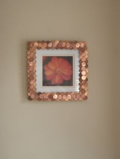 Penny Frame. Took a simple Salvation Army frame, a big bottle of super glue and a lot of pennies. Found by using contrasting old/new pennies it added a different element. I love the copper look!
