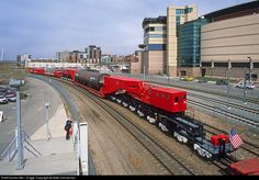 "Quite the overhang! Slowly moving northbound through Denver on the Joint Line on April 15, 2005, is a large 745-ton Bellele vessel being shipped from Houston, Texas, to Denver, Colorado, using the ""world's largest railroad car,"" Schnabel CEBX No. 800. The train is routed up the middle track for clearance reasons, as can be seen by the load shifting over to the near track on this particular curve that is fairly broad."