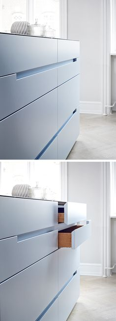 The Monolith kitchen from piqu normally uses servo-assisted drawer opening to allow for very narrow gaps between drawers. However we also have an alternative integrated handle for those who don't want or like the automatic opening. Here shown in baby blue lacquer.