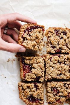 6 clean ingredients to make my FAVORITE jam bars! Consists of oat & almond flour, nut butter, and raspberry jam. SO yum! | asimplepalate.com