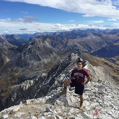 Student Joey G. sports his maroon and white on top of a mountain in Vorarlberg, Austria.
