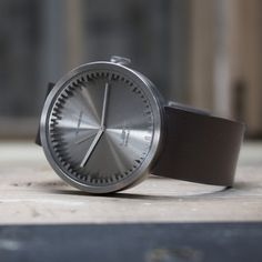 The face on the Tube Watch is surrounded by a serrated ring with cog-like indentations and protrusions that indicate the hours. The hour and minute indicators of the watch are integrated into a cylindrical casing rather than printed on the face #design #watches