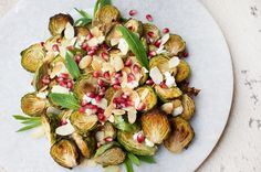 Maple-Roasted Brussels Sprouts with Almonds, Goat's Cheese & Pomegranate - JSHealth