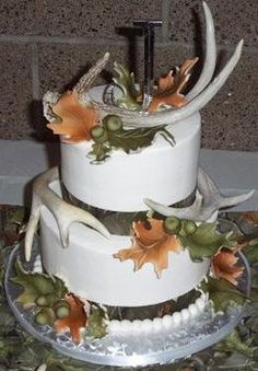 ok so maybe this cake minus the antlers with more fall looking leaves cascading down the side like a normal cake would be with flowers