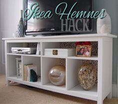 Ikea Hemnes sofa table as TV console. The top shelf should have 4 dividers but she left out 2 so she would have room for DVD player. She also put a backing on the unit with fabric covered plywood. Slim Tv Stand, Tv Stand Hack, Narrow Tv Stand, Tiny Living Rooms, My Living Room, Apartment Living, Tv Stand Ideas For Living Room, Hemnes Sideboard, Ikea Sofa Table
