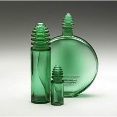 "Three Lalique ""Sans Adieu"" perfume and lotion bottles in emerald green glass, France, ca. 1929"