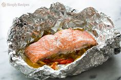 Foil Baked Salmon with Leeks and Bell Peppers ~ Salmon fillets, baked in foil over a bed of julienned red bell peppers and leeks. Gluten-free, paleo, and low-carb! ~ SimplyRecipes.com