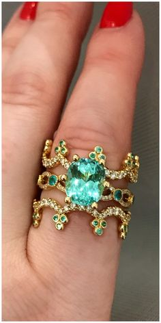 A Paraiba tourmaline wedding set by Erica Courtney. Would you ever consider a colored stone wedding stack?
