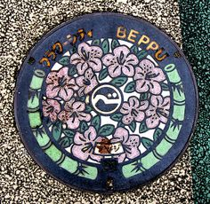 "Beppu in Oita styles itself ""flower town"" and is reflected in its choice of designs for manhole covers"