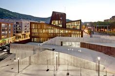 Perforated corten steel facade: night effect. OKE / AQ4 architecture