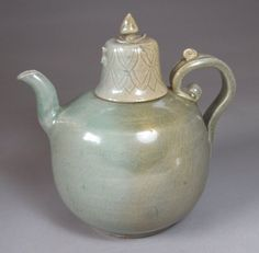 A Very Rare Koryo Celadon Ewer with Incised/Carved Lid