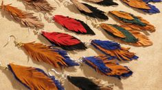 Earrings Fringed Leather Feather Dangle Suede Long by JewelActs, $29.00  https://www.etsy.com/listing/179641265/earrings-fringed-leather-feather-dangle?ref=shop_home_active_6