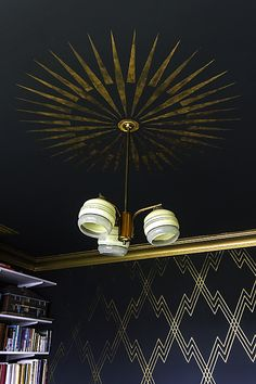 This house! Love the high contrast gold, and what a fun/funky chandelier.