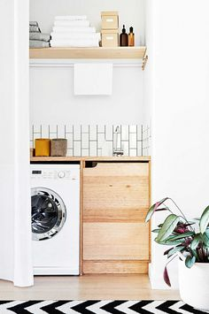 Minimalist drying line above the washing machine is a great idea. Also like open shelf at top; cheap way to add storage space.