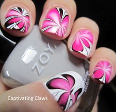 Pink, White, and Black Water Marble Nails