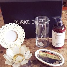 My first @burkedecor box! This is a cute little subscription box that sends a surprise selection of home goods to your doorstep.  It came with a photo frame carved from real bone a lotus shell tea light candle holder a glazed dish molded from a beach pebble taken from Shelter Island a bedside carafe with a tumbler and a bottle of Rosemary Mint lotion from #Apotheke.  I haven't seen a lot of home decor subscription boxes on the market so I thought I'd give this one a try. What do you think of…