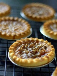 Rum and Raisin Butter Tarts You can purchase  the shells or make them. Filling  1/2 cup of dark rum 2 cups of raisins  Mixed rum and raisins. Soak for 30 minutes. Drain mixture and add 4 tablespoons of butter. Mix and add 1/2 cup of pecans. Bake for 20.mins @ 345 f