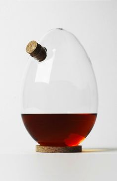 This egg-shaped spirit decanter by London designer Sebastian Bergne can be positioned at different angles without spilling its contents. Creative Artwork, Egg Shape, Glass Design, Wine Decanter, Industrial Design, Contemporary Design, Wine Glass, Alcoholic Drinks, Cool Designs