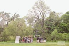 An overview shot of a ceremony in the field behind the Overbrook House in Buzzard's bay... Photography from one of our favorite Anthropologie styled weddings at the vintage & rustic Cape Cod wedding venue