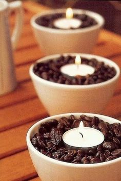 Place vanilla scented tea lights in a bowl of coffee beans. The warmth of the candles will heat up the coffee beans and make your house smell like french vanilla coffee. Table Centerpieces For Home, Candle Centerpieces, Diy Candles, Yankee Candles, Floral Centerpieces, Centerpiece Ideas, Wedding Centerpieces, Coffee Bean Candle, Coffee Beans