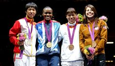 First-ever Olympic Medals awarded to women boxers. 10/08/2012  Nicola Adams from Great Britain, Katie Taylor from Ireland and Claressa Shields from the USA have won the first-ever Olympic gold medals in women's boxing in the categories of fly weight (51kg), light weight (60 kg) and middle weight (75 kg) respectively.