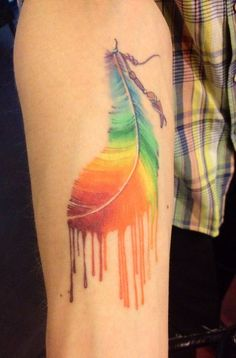 dripping rainbow feather-I like the idea of doing different colors in the feather...not the dripping part