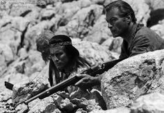 """Pierre Brice as Winnetou and Lex Barker as Old Shatterhand – The enormous success of the West German-Yugoslavian-French co-production """"The Treasure in the Silver Sea"""" (1962) marked the beginning of a whole series of films based on the popular novels of Karl May. The years 1962-1968 saw the production of seventeen films that reflected German conceptions of the American West. French actor Pierre Brice and American actor Lex Barker, who played the characters Winnetou and Old Shatterhand…"""