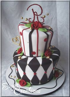 topsy turvy wedding cake with amazing details.  Black and white argyle, red roses.
