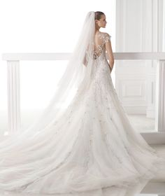 CENTAURUS - Wedding dress in layered tulle and lace. Collection Wedding Dresses 2015 ATELIER | Pronovias