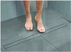 Schluter K Line Frameless Shower Grate The newest in shower drains that allow you to use large format tiles on shower floors and create a beautiful shower without the typical mosaic shower floor.
