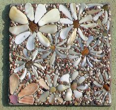 https://flic.kr/p/6a92ci | shell flowers | Flowers made from shell bits found at the beach, stones and sand glued onto a tile made of thinset.   (I'm experimenting.)