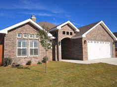 4 French Chateau Brick With Chocolate Stucco Garage Door