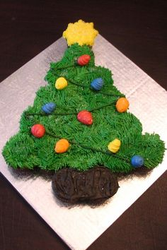 Christmas Tree Cupcake Cake by sweetpea8 on Cupcake Central just a picture but a cute idea, think I would make chocolate dipped strawberries for the bulbs!