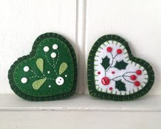 Items similar to Holly Christmas ornament, Felt heart Holiday ornament with holly leaves and berries on Etsy Felt Holiday ornament Felt Christmas ornament Holly Christmas Sewing, Christmas Embroidery, Christmas Diy, Holly Christmas, Handmade Christmas Gifts, Felt Christmas Decorations, Felt Christmas Ornaments, Diy Ornaments, Beaded Ornaments