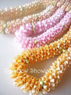 Ribbon leis for dancers & guests. One of my favorite ribbons leis. Ribbon Lei, Ribbon Garland, Ribbon Work, Ribbon Crafts, Flower Crafts, Ribbons, Hawaiian Crafts, Hawaiian Art, Flower Garland Wedding