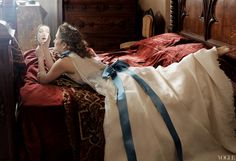Chanel white satin dress with beaded lace overlay and Alice-blue ribbons. All in Annie Leibovitz eyes. Vogue.