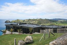The house has a spectacular site, with commanding views down to Hahei beach and along the Coromandel coastline. Beach Houses, Architecture Design, Environment, Explore, Landscape, Building, Plants, Travel, Beach Homes