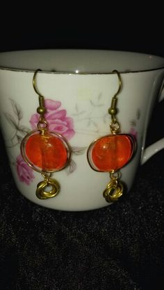 """""""butterscotch"""" earrings with rosette charm"""