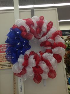 Red white and blue deco mesh wreath -- how creative! This would be great for Veteran's Day in November.