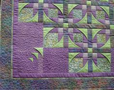 Corner of Mexican Star. by Michele. While the quilting is very simple in this wall hanging (stippling and bubbles/stones patterns), it effectively showcases the block design.