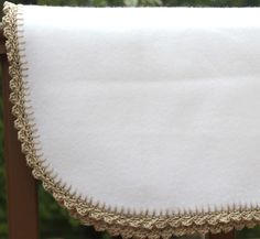 Crochet edge using a base row of embroidered blanket stitch. Much easier than punching holes!