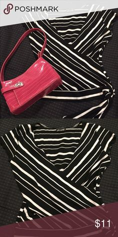 Black and white striped shirt with cute tassel. Black and white striped shirt with cute side tassel that you can tie in a bow, knots, your own flare. Size medium, 94% acrylic, 6% spandex. Purse sold separately and can be bundled. Shirt is like new. Very cute!! Voir Mozart Tops Tees - Short Sleeve