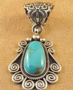 Handmade pendant, with natural Royston Turquoise, by Navajo artist Terry Martinez.