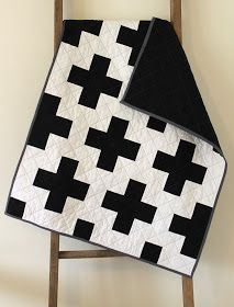 craftyblossom: black and white cross quilt. So simple and yet so neat!  Love the grey binding!